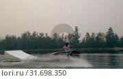 Купить «Man wakeboarding in the river 4k», видеоролик № 31698350, снято 22 августа 2018 г. (c) Wavebreak Media / Фотобанк Лори