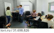 Купить «Business people discussing over whiteboard 4k», видеоролик № 31698826, снято 14 июля 2018 г. (c) Wavebreak Media / Фотобанк Лори