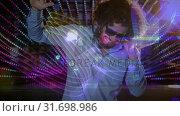 Купить «Digital animation showing smiling disco jockey mixing music in pub 4k», видеоролик № 31698986, снято 26 октября 2018 г. (c) Wavebreak Media / Фотобанк Лори