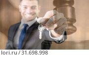 Купить «Digital animation of real estate agent holding keys 4k», видеоролик № 31698998, снято 26 октября 2018 г. (c) Wavebreak Media / Фотобанк Лори