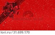 Купить «Digital animation of red ribbon with gift bow against red background 4k», видеоролик № 31699170, снято 26 октября 2018 г. (c) Wavebreak Media / Фотобанк Лори