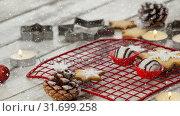 Купить «Falling snow with Christmas decoration», видеоролик № 31699258, снято 2 ноября 2018 г. (c) Wavebreak Media / Фотобанк Лори