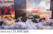 Купить «Candles and christmas decoration outside a window combined with falling snow», видеоролик № 31699566, снято 2 ноября 2018 г. (c) Wavebreak Media / Фотобанк Лори
