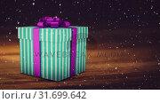 Купить «Falling snow with Christmas gift», видеоролик № 31699642, снято 2 ноября 2018 г. (c) Wavebreak Media / Фотобанк Лори