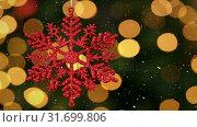 Купить «Video composition with falling snow over blurry video of Christmas tree lights and snowflake», видеоролик № 31699806, снято 2 ноября 2018 г. (c) Wavebreak Media / Фотобанк Лори