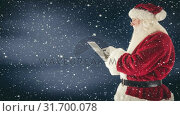 Купить «Santa clause interacting with his tablet combined with falling snow», видеоролик № 31700078, снято 2 ноября 2018 г. (c) Wavebreak Media / Фотобанк Лори