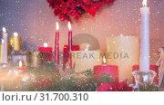 Купить «Candles and christmas decoration combined with falling snow», видеоролик № 31700310, снято 2 ноября 2018 г. (c) Wavebreak Media / Фотобанк Лори