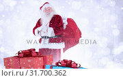 Купить «Santa clause with christmas presents combined with falling snow», видеоролик № 31700362, снято 2 ноября 2018 г. (c) Wavebreak Media / Фотобанк Лори