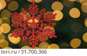 Купить «Falling snow and snowflake Christmas decoration», видеоролик № 31700366, снято 2 ноября 2018 г. (c) Wavebreak Media / Фотобанк Лори