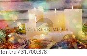 Falling snow with Christmas candles decoration. Стоковое видео, агентство Wavebreak Media / Фотобанк Лори