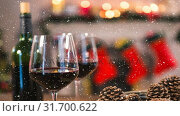 Купить «Falling snow with Christmas wine», видеоролик № 31700622, снято 2 ноября 2018 г. (c) Wavebreak Media / Фотобанк Лори