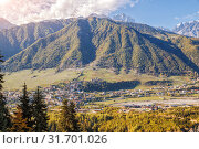 Caucasian landscape, aerial view of the town Mestia in mountain valley. Upper Svaneti, Georgia (2018 год). Стоковое фото, фотограф Юлия Бабкина / Фотобанк Лори