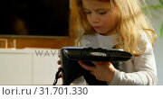 Купить «Adorable girl looking at virtual reality headset at home 4k», видеоролик № 31701330, снято 30 августа 2018 г. (c) Wavebreak Media / Фотобанк Лори