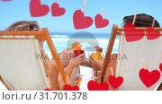 Купить «Happy couple toasting on beach», видеоролик № 31701378, снято 6 ноября 2018 г. (c) Wavebreak Media / Фотобанк Лори