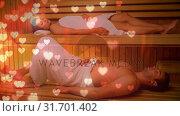 Купить «Couple relaxing in sauna», видеоролик № 31701402, снято 6 ноября 2018 г. (c) Wavebreak Media / Фотобанк Лори