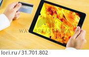 Купить «Digital animation of dollar bills falling on the fire flames in digital tablet», видеоролик № 31701802, снято 12 ноября 2018 г. (c) Wavebreak Media / Фотобанк Лори