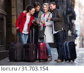 Купить «Portrait of tourists with map and baggage seeing the sights in European city», фото № 31703154, снято 24 августа 2019 г. (c) Яков Филимонов / Фотобанк Лори