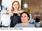 Hairdresser does to woman haircut with use of scissors and hairbrushes. Стоковое фото, фотограф Яков Филимонов / Фотобанк Лори