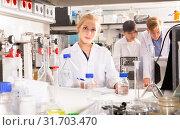 Купить «Adult female student noting results of research», фото № 31703470, снято 28 мая 2019 г. (c) Яков Филимонов / Фотобанк Лори
