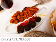 Купить «Blood sausage, chorizo, picadillo and baked cherry peppers», фото № 31703630, снято 23 июля 2019 г. (c) Яков Филимонов / Фотобанк Лори