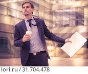 Купить «Portrait of busy man in suit rushing», фото № 31704478, снято 29 апреля 2017 г. (c) Яков Филимонов / Фотобанк Лори