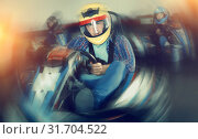 Купить «Portrait of male racer in helmet driving kart on track», фото № 31704522, снято 20 сентября 2019 г. (c) Яков Филимонов / Фотобанк Лори