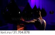 Купить «Female boxer practicing boxing in fitness studio », видеоролик № 31704878, снято 25 мая 2018 г. (c) Wavebreak Media / Фотобанк Лори