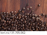 Coffee beans on dark wooden background. Стоковое фото, фотограф Яков Филимонов / Фотобанк Лори