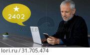 Купить «Man working on his laptop while browsing on his phone 4k», видеоролик № 31705474, снято 5 апреля 2019 г. (c) Wavebreak Media / Фотобанк Лори