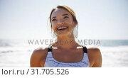 Beautiful woman leaning on railing at beach 4k. Стоковое видео, агентство Wavebreak Media / Фотобанк Лори