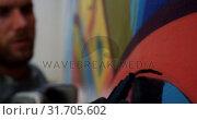 Купить «Graffiti artist painting with marker on the wall 4k», видеоролик № 31705602, снято 4 февраля 2019 г. (c) Wavebreak Media / Фотобанк Лори