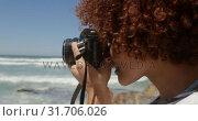 Купить «Woman taking photo with digital camera on the beach 4k», видеоролик № 31706026, снято 14 февраля 2019 г. (c) Wavebreak Media / Фотобанк Лори