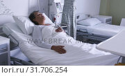Купить «Woman lying in a hospital bed 4k», видеоролик № 31706254, снято 10 марта 2019 г. (c) Wavebreak Media / Фотобанк Лори