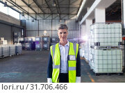 Купить «Mature female staff in reflective jacket standing in warehouse», фото № 31706466, снято 23 марта 2019 г. (c) Wavebreak Media / Фотобанк Лори