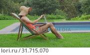 Купить «Woman relaxing on chair in the backyard 4k», видеоролик № 31715070, снято 12 марта 2019 г. (c) Wavebreak Media / Фотобанк Лори