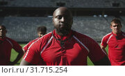 Купить «Male rugby player standing with hands on hip in stadium 4k», видеоролик № 31715254, снято 9 мая 2019 г. (c) Wavebreak Media / Фотобанк Лори