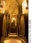 Купить «Cellar with barrels for storage of wine,», фото № 31722398, снято 16 мая 2014 г. (c) Наталья Волкова / Фотобанк Лори