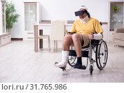 Купить «Young man after accident recovering at home», фото № 31765986, снято 3 мая 2019 г. (c) Elnur / Фотобанк Лори