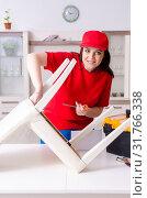 Купить «Young woman repairing chair at home», фото № 31766338, снято 19 марта 2019 г. (c) Elnur / Фотобанк Лори