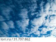 Купить «Небесный закатный пейзаж. Синее небо. Blue dramatic sky background - white dramatic colorful clouds lit by sunlight. Vast sky landscape panorama», фото № 31797862, снято 26 октября 2018 г. (c) Зезелина Марина / Фотобанк Лори