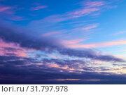 Купить «Небесный закатный пейзаж. Синее небо. Sunset dramatic sky background - pink, orange and blue dramatic colorful clouds lit by evening sunset light», фото № 31797978, снято 21 ноября 2018 г. (c) Зезелина Марина / Фотобанк Лори