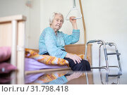 Elderly 96 years old woman sitting on medical bed in hospic. Стоковое фото, фотограф Matej Kastelic / Фотобанк Лори