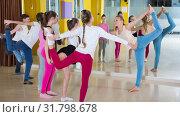 Купить «Teenagers with choreographer doing leg-split and crab position», фото № 31798678, снято 3 марта 2018 г. (c) Яков Филимонов / Фотобанк Лори