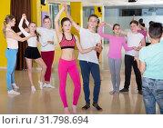 Купить «Teenagers in pairs learning to dance active boogie-woogie», фото № 31798694, снято 3 марта 2018 г. (c) Яков Филимонов / Фотобанк Лори