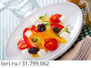 Купить «Delicious salad with tomatoes, cucumber, feta cheese and paprika», фото № 31799062, снято 20 сентября 2019 г. (c) Яков Филимонов / Фотобанк Лори