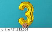 Купить «Gold foil number 3 three celebration balloon», видеоролик № 31813554, снято 24 июля 2019 г. (c) Ekaterina Demidova / Фотобанк Лори