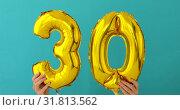 Купить «Gold foil number 30 thirty celebration balloon», видеоролик № 31813562, снято 24 июля 2019 г. (c) Ekaterina Demidova / Фотобанк Лори