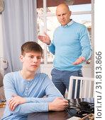 Купить «Man scolding son at home», фото № 31813866, снято 7 апреля 2019 г. (c) Яков Филимонов / Фотобанк Лори