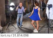 Купить «Photographer shooting female model on city street», фото № 31814098, снято 5 октября 2018 г. (c) Яков Филимонов / Фотобанк Лори