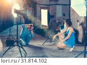 Купить «Photographer shooting female model on city street», фото № 31814102, снято 5 октября 2018 г. (c) Яков Филимонов / Фотобанк Лори